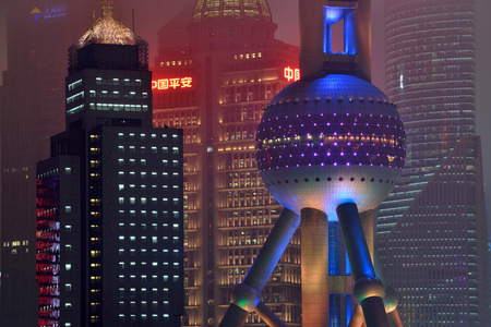 pudong district: SHANGHAI, CHINA - MARCH 19: Pudong district night view from Suzhou Creek on March 19, 2016 in Shanghai, China. Pudong is a district of Shanghai, located east of the Huangpu River.