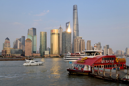 pudong district: SHANGHAI, CHINA - MARCH 25: Pudong district view from The Bund waterfront area on March 25, 2016 in Shanghai, China. Pudong is a district of Shanghai, located east of the Huangpu River. Editorial