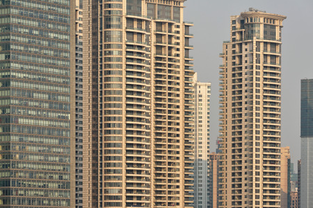 megapolis: Pudong district skyscrapers in Shanghai, China. Pudong is a district of Shanghai, located east of the Huangpu River. Stock Photo