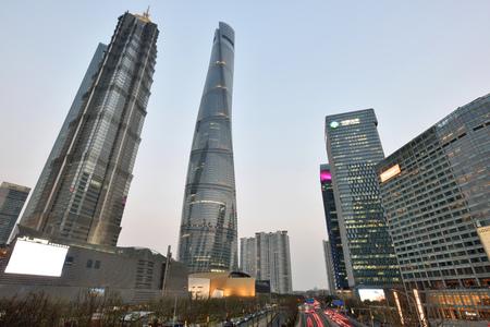 pudong district: SHANGHAI, CHINA - MARCH 25: Pudong district evening view on March 25, 2016 in Shanghai, China. Pudong is a district of Shanghai, located east of the Huangpu River.