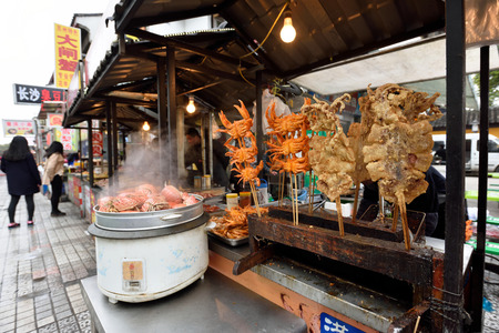 culinary tourism: SUZHOU, CHINA - MARCH 22: Unidentified Chinese people trade food on March 22, 2016 in China. Suzhou is a major economic center and focal point of trade and commerce in Jiangsu Province, China Editorial