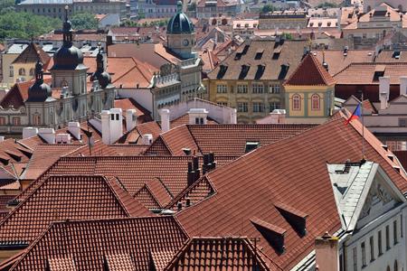 flue season: Tile roofs of the old city Prague, Czech Republic