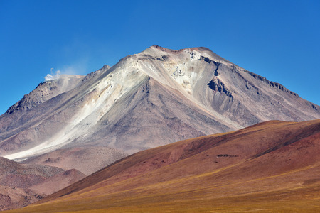 stratovolcano: Ollague or Ullawi is a massive andesite stratovolcano in the Andes on the border between Bolivia and northern Chile. Stock Photo