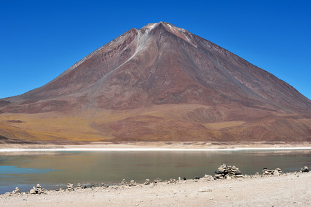 Licancabur is a highly symmetrical stratovolcano on the southernmost part of the border between Chile and Bolivia