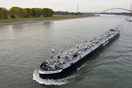 DUISBURG, GERMANY - November 04: Barge on the river Rhine on November 04, 2016 in Duisburg, Germany. Duisburg is the largest river port in Europe (Duisport) Editorial