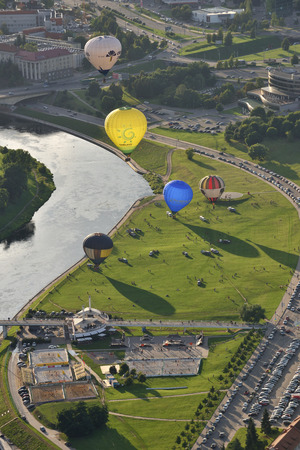 permitted: VILNIUS, LITHUANIA - AUGUST 11 2016: Hot air balloons in Vilnius city center on August 11, 2016 in Vilnius, Lithuania. Vilnius is one of few cities where hot air ballooning over the city is permitted.