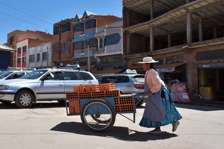DESAGUADERO, BOLIVIA - August 25, 2016: Unidentified people on street of Desaguadero, Bolivia on August 25, 2016. Desaguadero is a town on the Bolivian-Peruvian border. Editorial