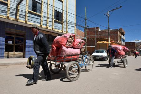 ramshackle: DESAGUADERO, BOLIVIA - August 25, 2016: Unidentified people on street of Desaguadero, Bolivia on August 25, 2016. Desaguadero is a town on the Bolivian-Peruvian border. Editorial