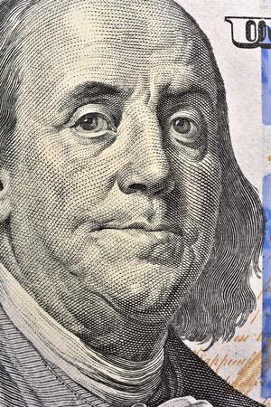 Benjamin Franklin face on USA one hundred dollar bill, macro close up