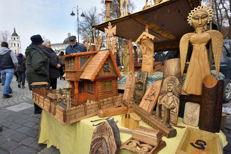 tradespeople: VILNIUS, LITHUANIA - MARCH 4: Traditional Lithuanian wood sculptures in annual traditional crafts fair - Kaziuko fair on March 4, 2017 in Vilnius, Lithuania Editorial