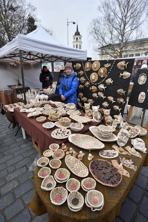 tradespeople: VILNIUS, LITHUANIA - MARCH 4: Unidentified people trade traditional souvenirs in annual crafts fair - Kaziuko fair on March 4, 2017 in Vilnius, Lithuania Editorial