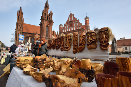 tradespeople: VILNIUS, LITHUANIA - MARCH 4: Unidentified people trade traditional wooden masks in annual traditional crafts fair - Kaziuko fair on March 4, 2017 in Vilnius, Lithuania