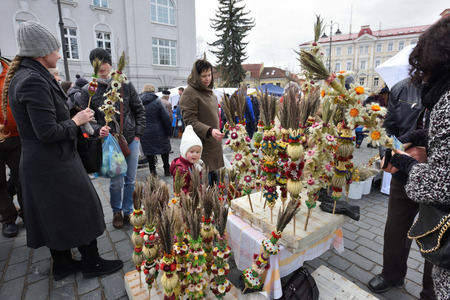 tradespeople: VILNIUS, LITHUANIA - MARCH 4: Unidentified people trade traditional palm bouquets in annual traditional crafts fair - Kaziuko fair on Mar 4, 2017 in Vilnius, Lithuania Editorial