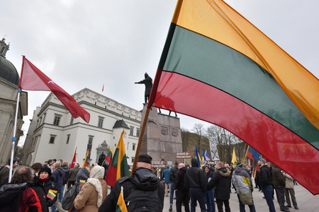 reestablishment: VILNIUS, LITHUANIA - MAR 11: Around one thousand people gathered with flags in a nationalist rally at Gedimino Avenue on Re-Establishment of Independence Day on March 11, 2017 in Vilnius, Lithuania Editorial