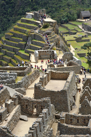 cultural artifacts: MACHU PICCHU PERU - September 02, 2016: Tourists walk in Machu Picchu site on September 02 2016. Machu Picchu Unesco World Heritage site and New 7 Wonder of the world.