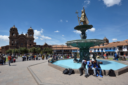 declared: CUSCO PERU - September 05, 2016: Unidentified people in Plaza De Armas of Cusco Peru on September 05, 2016. In 1983 Cusco was declared a World Heritage Site by UNESCO.
