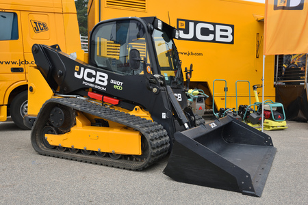 compact track loader: VILNIUS, LITHUANIA - APRIL 27: JCB 320T vertical lift compact track loader on April 27, 2017 in Vilnius, Lithuania. JCB corporation is manufacturing equipment for construction and agriculture.