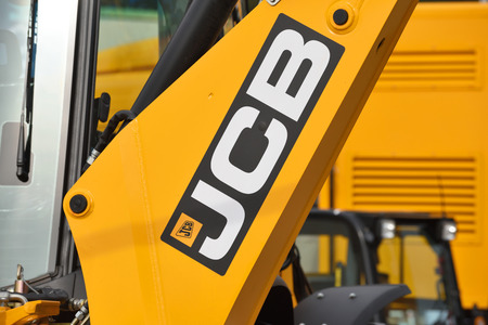 construction vehicle: VILNIUS, LITHUANIA - APRIL 27: JCB heavy duty equipment vehicle and logo on April 27, 2017 in Vilnius, Lithuania. JCB corporation is manufacturing equipment for construction and agriculture. Editorial