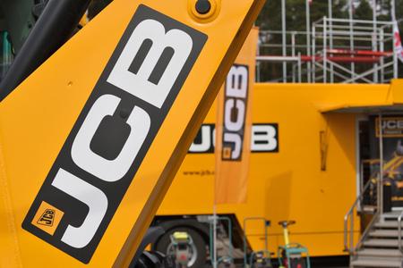 VILNIUS, LITHUANIA - APRIL 27: JCB heavy duty equipment vehicle and logo on April 27, 2017 in Vilnius, Lithuania. JCB corporation is manufacturing equipment for construction and agriculture. Redakční