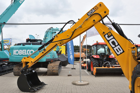 manufacturing equipment: VILNIUS, LITHUANIA - APRIL 27: JCB heavy duty equipment vehicle and logo on April 27, 2017 in Vilnius, Lithuania. JCB corporation is manufacturing equipment for construction and agriculture. Editorial
