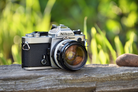 VILNIUS - MAY 8: Nikon vintage film camera with Nikkor 35mm lens on May 8, 2017 in Vilnius, Lithuania. Nikon Corporation specializing in optics and imaging products.