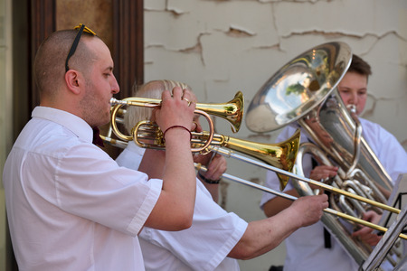 musical score: VILNIUS, LITHUANIA - MAY 20: Unidentified musician play trumpet in Street Music Day on May 20, 2017 in Vilnius. Its a most popular event on May in Vilnius, Lithuania