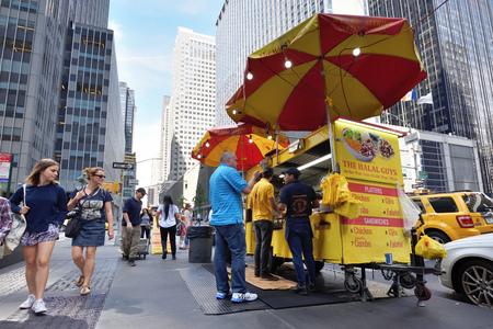 NEW YORK CITY, USA - AUG. 28: Street food cart in Manhattan on August 28, 2017 in New York City, NY. Manhattan is the most densely populated borough of New York City. Editorial