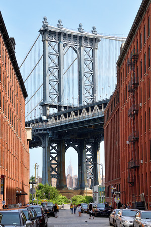 NEW YORK CITY - AUG. 27: Manhattan bridge view from Brooklyn Dumbo neighborhood on August 27, 2017 in New York City, NY. Manhattan Bridge connects boroughs of Manhattan and Brooklyn over East River