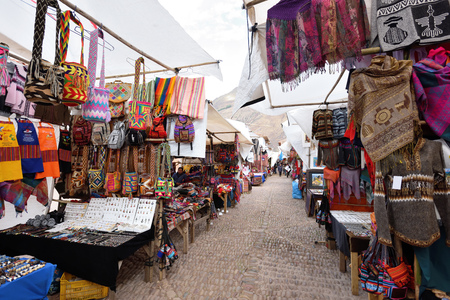 PISAC, PERU - September 04, 2016: Colourful goods for sale in marketplace in Pisac, Peru on September 04, 2016. Pisac is a town and an Inca archaeological site in Peru. Redakční