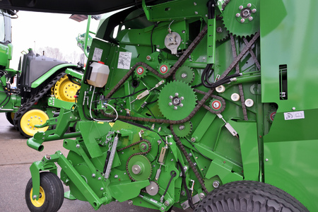 Kaunas, Lithuania - March 23: John Deere tractors engine on March 23, 2018 in Kaunas, Lithuania. John Deere is the American corporation that manufactures agricultural and forestry machinery. Editorial