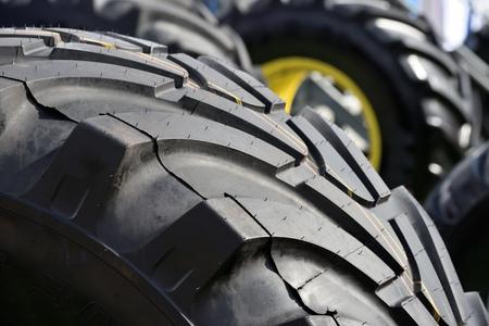 Big truck wheel a black tires closeup