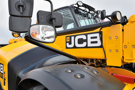 Kaunas, Lithuania - March 23: JCB heavy duty equipment vehicle and logo on March 23, 2018 in Kaunas, Lithuania. JCB corporation is manufacturing equipment for construction and agriculture. Editoriali