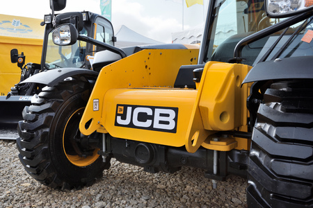 Kaunas, Lithuania - March 23: JCB heavy duty equipment vehicle and logo on March 23, 2018 in Kaunas, Lithuania. JCB corporation is manufacturing equipment for construction and agriculture. Redakční
