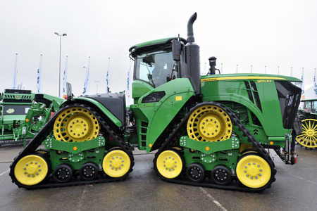 Kaunas, Lithuania - March 23: John Deere tractor on March 23, 2018 in Kaunas, Lithuania. John Deere is the American corporation that manufactures agricultural and forestry machinery.