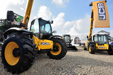 Kaunas, Lithuania - March 23: JCB heavy duty equipment vehicle and logo on March 23, 2018 in Kaunas, Lithuania. JCB corporation is manufacturing equipment for construction and agriculture. Editorial