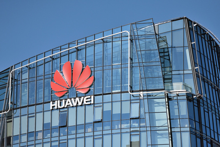 Vilnius, March 27: Huawei logo on a building on March 27 2018 in Vilnius, Lithuania. Huawei is a Chinese multinational networking and telecommunications equipment and services company. Фото со стока - 98650959