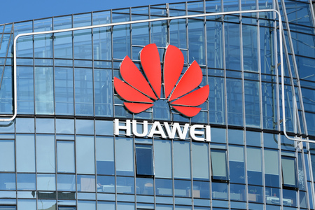 Vilnius, March 27: Huawei logo on a building on March 27 2018 in Vilnius, Lithuania. Huawei is a Chinese multinational networking and telecommunications equipment and services company.