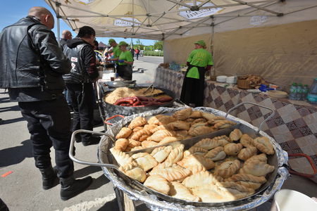 Vilnius, Lithuania - May 5: Unidentified people trade food on annual gathering of bikers on May 5, 2018 in Vilnius Lithuania. This is traditional motorbikers event during spring in Vilnius.