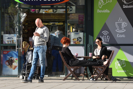Vilnius, Lithuania - May 19: Unidentified people in Vilnius Old Town cafe on May 19, 2018 in Vilnius Lithuania. Vilnius is the capital of Lithuania and its largest city.