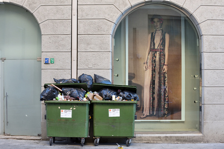 Vilnius, Lithuania - May 19: Green containers with garbage in Vilnius Old Town on May 19, 2018 in Vilnius Lithuania. Vilnius is the capital of Lithuania and its largest city.