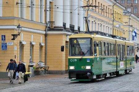 Helsinki, Finland - August 30: tram on street of Helsinki, Finland at August 30, 2018. Tram in Helsinki is a widespread type of public transport Редакционное