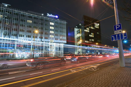 Vilnius, Lithuania, October 31: Night traffic, city street on October 31, 2018 in Vilnius, Lithuania. Vilnius is the capital of Lithuania and its largest city.