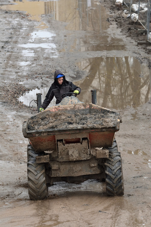 Vilnius, Lithuania - February 16: Small Dump Truck hauling ground during road construction on February 16, 2019. Vilnius is the capital of Lithuania and its largest city.
