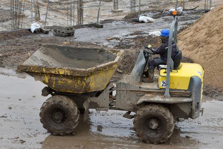 Small Dump Truck hauling ground during road construction Reklamní fotografie