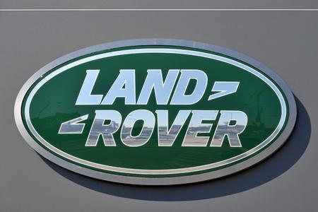 Vilnius, Lithuania - April 02: Land Rover car logotype on the wall in Vilnius on April 02, 2018. Land Rover - Brand British transnational carmaker Jaguar - Land Rover. Editorial