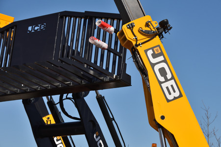 Kaunas, Lithuania - April 04: JCB heavy duty equipment vehicle and logo in Kaunas on April 04, 2019.  JCB corporation is manufacturing equipment for construction and agriculture Editoriali