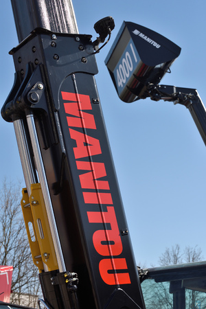 Kaunas, Lithuania - April 04: Manitou forklift tractor detail and logo in Kaunas on April 04, 2019. Manitou is a firm that makes fork lifts, cherry pickers, and other heavy equipment Editorial