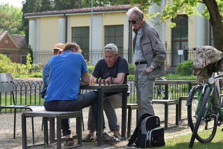 Vilnius, Lithuania - May 18: Unidentified people play chess in a park on May 18, 2019 in Vilnius Lithuania. Vilnius is the capital of Lithuania and its largest city. Sajtókép