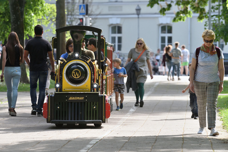 Vilnius, Lithuania - May 18: Unidentified people in childrens summer attraction locomotive on May 18, 2019 in Vilnius Lithuania. Vilnius is the capital of Lithuania and its largest city. Editorial