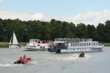 Mikolajki, Poland, July 12: Boat at Sniardwy lake on July 12, 2020 at Mikolajki, Poland. Sniardwy is a lake in the Masurian Lake District of the Warmian-Masurian Voivodeship, Poland Publikacyjne